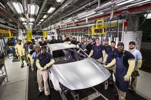 how much does it cost ford to build a car