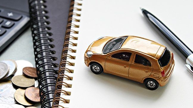 picture of car on a note pad