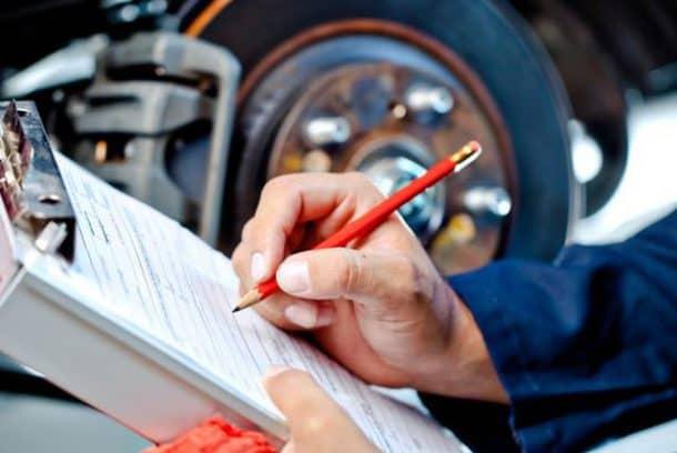 a man doing car inspection